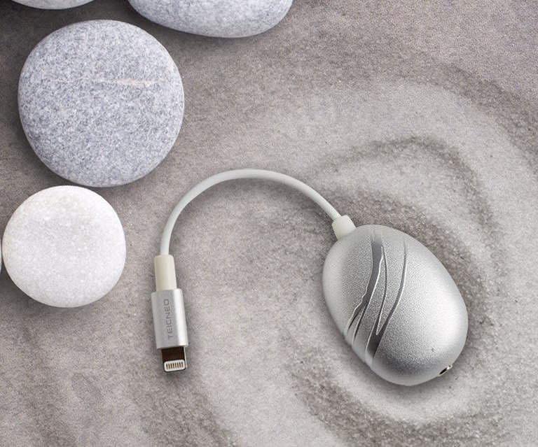 Мини-усилитель Cobble для iPhone в форме гальки